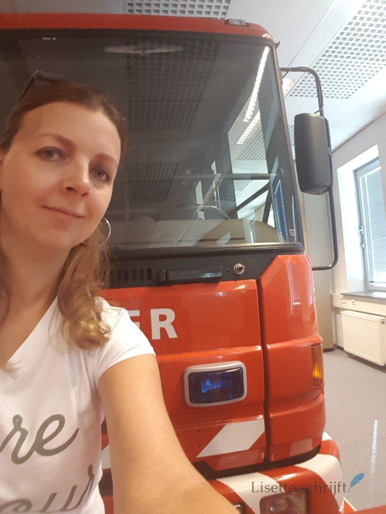 Lisette met de brandweerauto Lisette Schrijft